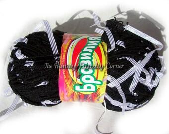 Yarn with tassels. Yarn Brasilia in black with white tassels. Unique ladder yarn with ribbon pendants tassels. White on black.