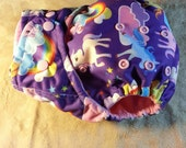 SassyCloth one size pocket cloth diaper with rainbow unicorns PUL print. Made to order.