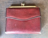Genuine Cowhide ROLFS Burgandy Ladies Wallet. kiss lock snaps .Coin purse. Picture pack holders.New old stock.