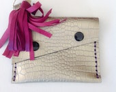 silver leather wallet with magenta tassel