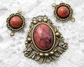 Three Piece Set of Coral Matrix Resin Cabochons in Brass Settings