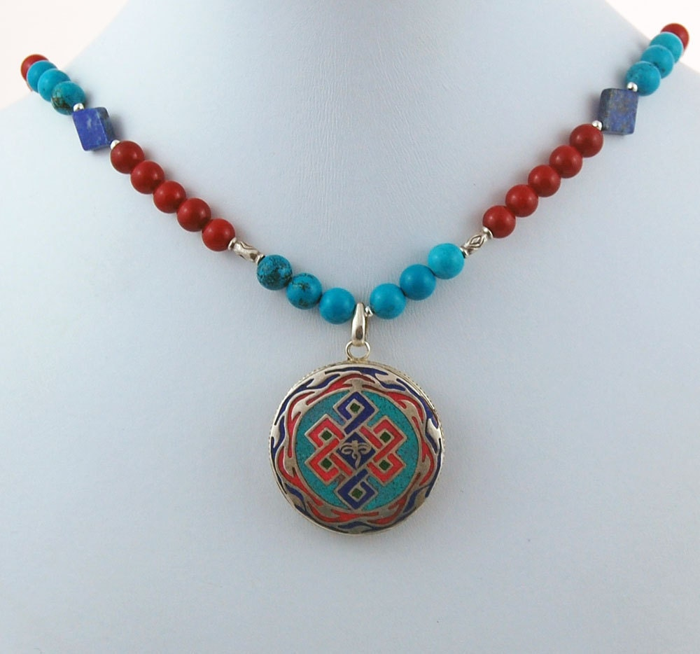 tibetan endless knot sterling silver pendant with turquoise