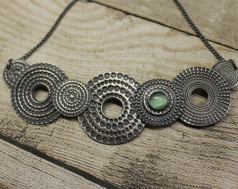 Circle dot necklace with green cateye cabochon