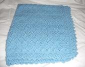 handknitted baby blanket in Mariner dk wool in blue