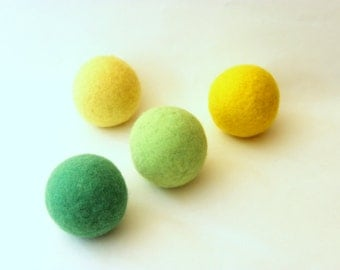 Wool dryer balls set of 4, yellow + green. Handmade of 100% wool. Replaces fabric softener & dryer sheets. Natural laundry care.
