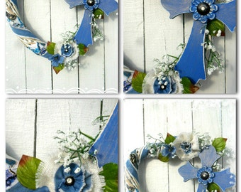 Cross my heart!  White heart shaped door wreath with denim trim and Burlap flowers with rhinestone centers. Very light and fresh door accent