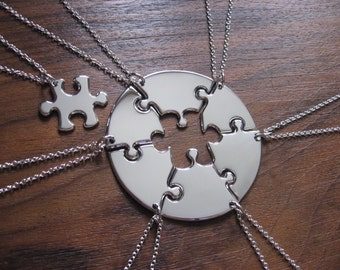 Seven Silver Round Puzzle Pendant Necklaces