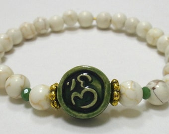 White Magnesite Beaded Bracelet with Green Ceramic Om Charm and Gold/Green Spacers