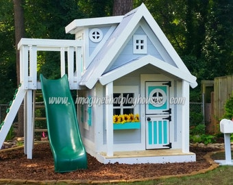 The Residence Playouse with dormer,  slide platform, interior loft, interior paint and the fun package!