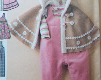Cozy up baby! Adorable Baby Poncho and romper  and booties pattern Simplicity 4054 Uncut