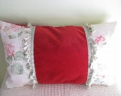 Pillow cushion cover middle soft upholstery fabric in cherry red, connected with floral with matching tassel trim.