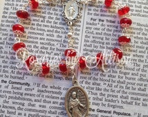 St. Maximilian Kolbe chaplet with ornate Miraculous Mary center and Ruby Rondelle Czech glass beads