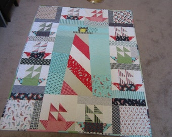 PDF pattern Lighthouse and Sailboats Lap quilt using Moda Daysail collection layer cake in blue, red, green, and white