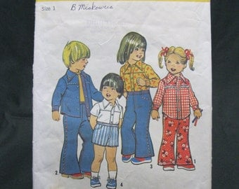 Size 1 yoked, front buttoned, collared shirt has shaped hemline, shorts and bell bottom pants with elastic waists, boys and girls, western