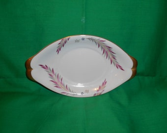"One (1), 9"" Oval Underplate, for Gravy Boat, (Occupied Japan)  from Meito-Norleans, in the Chatham (F & G Japan) Pattern."