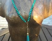 green + tassel necklace