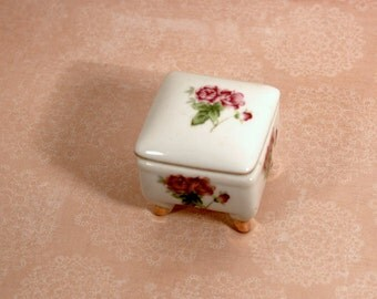 White and floral trinket box with legs made in Korea