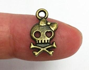 12pc 16x9mm antique bronze finish metal  skull pendant-7132h