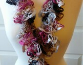 Hand knitted scarf using Starbella yarn- Magic Potions  - Pink, Black, White, Tan and Grey
