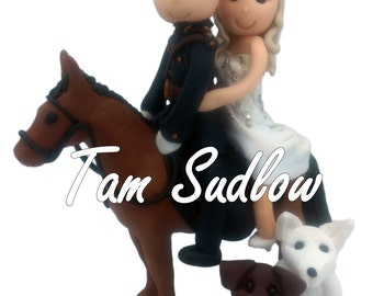 Personalised Bride and Groom Wedding Cake toppers Bride and groom on a horse