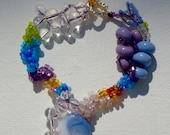 Bracelet peyote free form. Unusual. Beautiful purple, blue, lilac and gold glass beads. Silver toggle clasp. Handmade gift