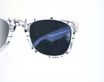 white glasses with music inspiration