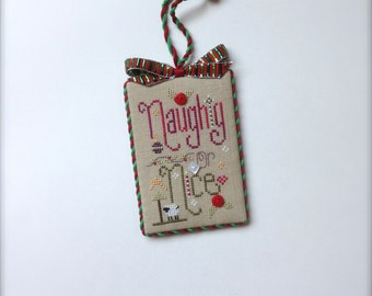 Completed primitive cross stitch Naughty or Nice Christmas ornament / Christmas decoration