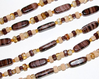 Vintage Glass Bead Flapper necklace in shades of Creams and Brown.
