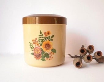 Vintage Canister, Australian made by the British Plastics Company. 1960 / 1970 floral design.