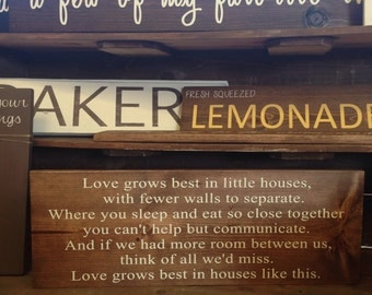 Love grows in little house wood sign