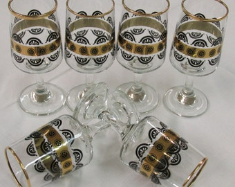 Funky set of six black and gold sherry glasses