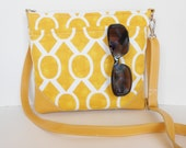 Yellow crossbody bag with leather trim, adjustable strap.