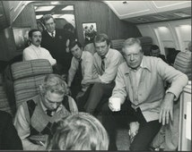 President Carter and Edmund Muskie w staffers on airplane photo by B. Thumma