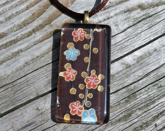 Glass pendant necklace made with Japanese Chiyogami paper and silver bail - light blue and orange flowers on a brown colored background