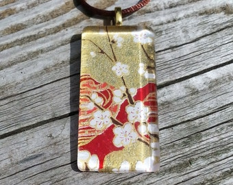 Glass pendant necklace made with Japanese Chiyogami paper and silver bail - white flowers on red and gold background