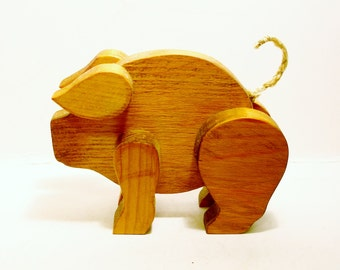 Handcrafted Expressive Wooden Pig with Curly Tail