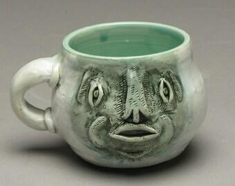 Greyface the Mug