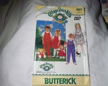 Vintage 80's Butterick pattern #4053, infant/toddler dress/jumper with matching Cabbage Patch pattern UNCUT!!!!!! size 1-2-3