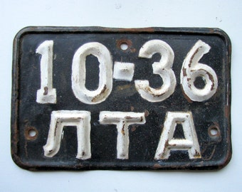 Vintage Soviet Latvia car license plate, collectible. Metal plate with black background and white embossed numbers, letters. 60s