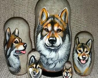 Eurasier on Five Russian Nesting Dolls. Dogs.
