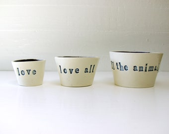Love.  Love All.  Love All The Animals. Three Petite Hand-Built Nesting Ceramic Bowls.  In Two Shades Of Blue.