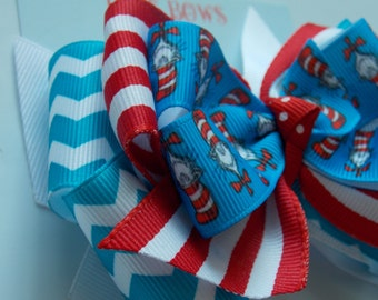 The cat in the hat  hair bow .  baby hair clip . Thing 1 and thing 2 bow 5 inch . Dr Seuss inspired bow
