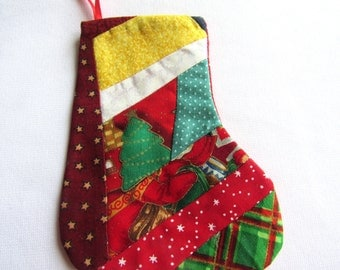 Gift card holder, or Christmas ornament done in crazy quilt sewing to create top width at top is 2 3/4 inches, length 5 inches.