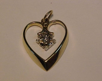 10k/14k gold heart with tested diamond-1.9 grams -hallmarked.