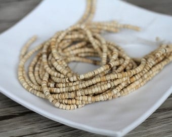 2-3mm Natural Coconut Shell Pucalet Rondelle Beads - Waxed -15 inch strand