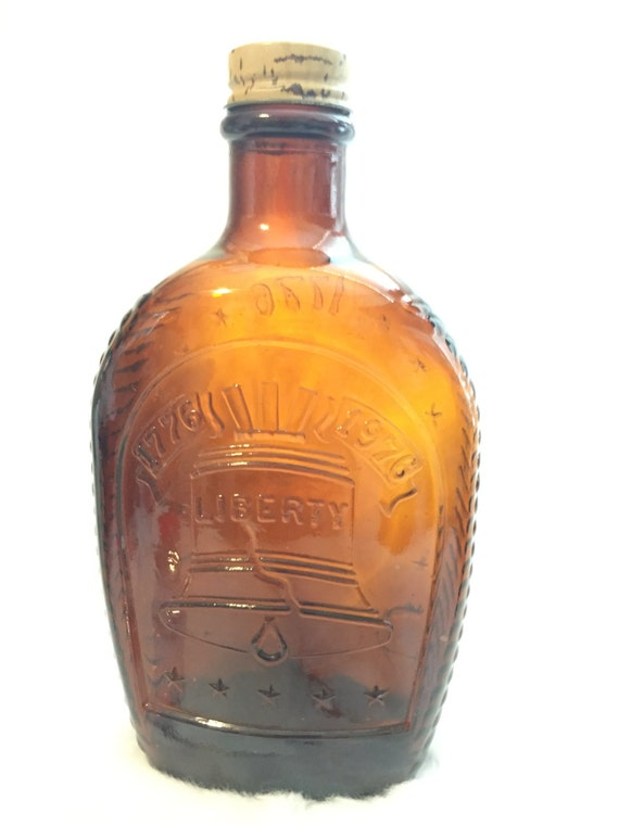 Vintage log cabin syrup bottle liberty bell