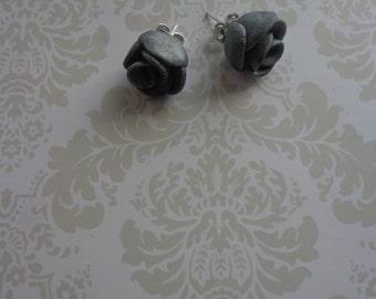 Silver rose earrings.