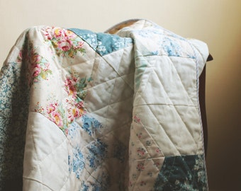 lap or baby quilt, tilda fabric, blue and white, floral pattern.