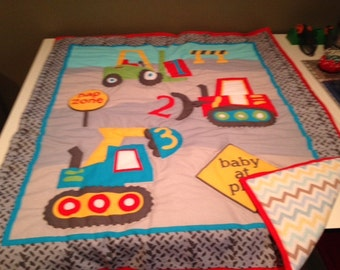 Hand quilted quilt with trucks