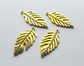 Tibetan Golden pk of 4 Leaf Pendants 46x22mm